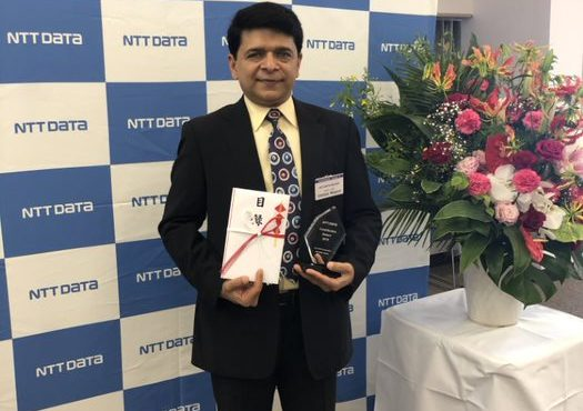 ICC director Chetan Mepani receiving the Community Services award by NTT Data in Tokyo, Japan in 2019